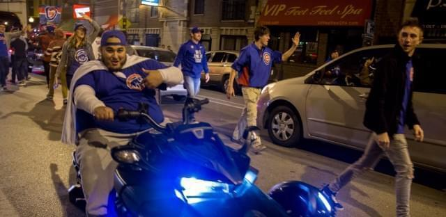 Cubs fans celebrate on Clark Street after the team won the National League Championship Series Saturday night.
