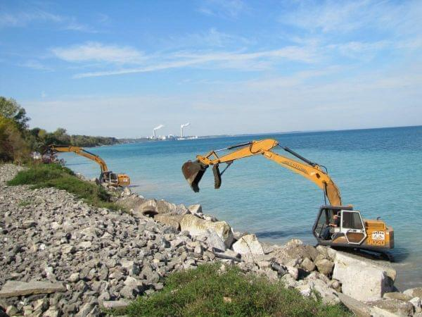Heavy machinery used to slow erosion along Lake Michigan in southern Wisconsin.