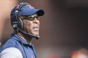 Illinois head coach Lovie Smith looks at the scoreboard during the second quarter of an NCAA college football game against Minnesota, Saturday, Oct. 29, 2016, at Memorial Stadium in Champaign