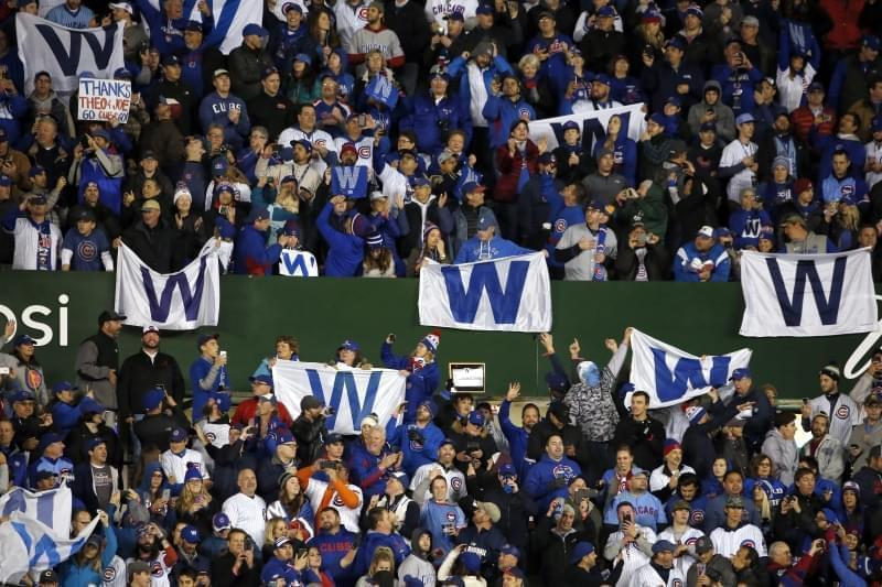 Chicago Cubs fans cheer after Game 5 of the World Series between the Chicago Cubs and the Cleveland Indians, Sunday, Oct. 30, 2016, in Chicago. The Cubs won 3-2 as the Indians lead the series 3-2.
