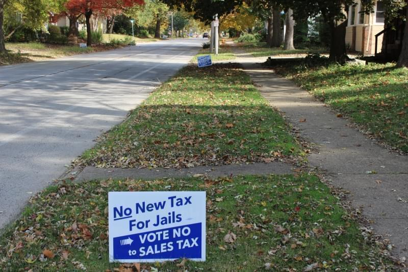 Two yard signs in Urbana show opposition for proposed sales tax increase for facilities projects.