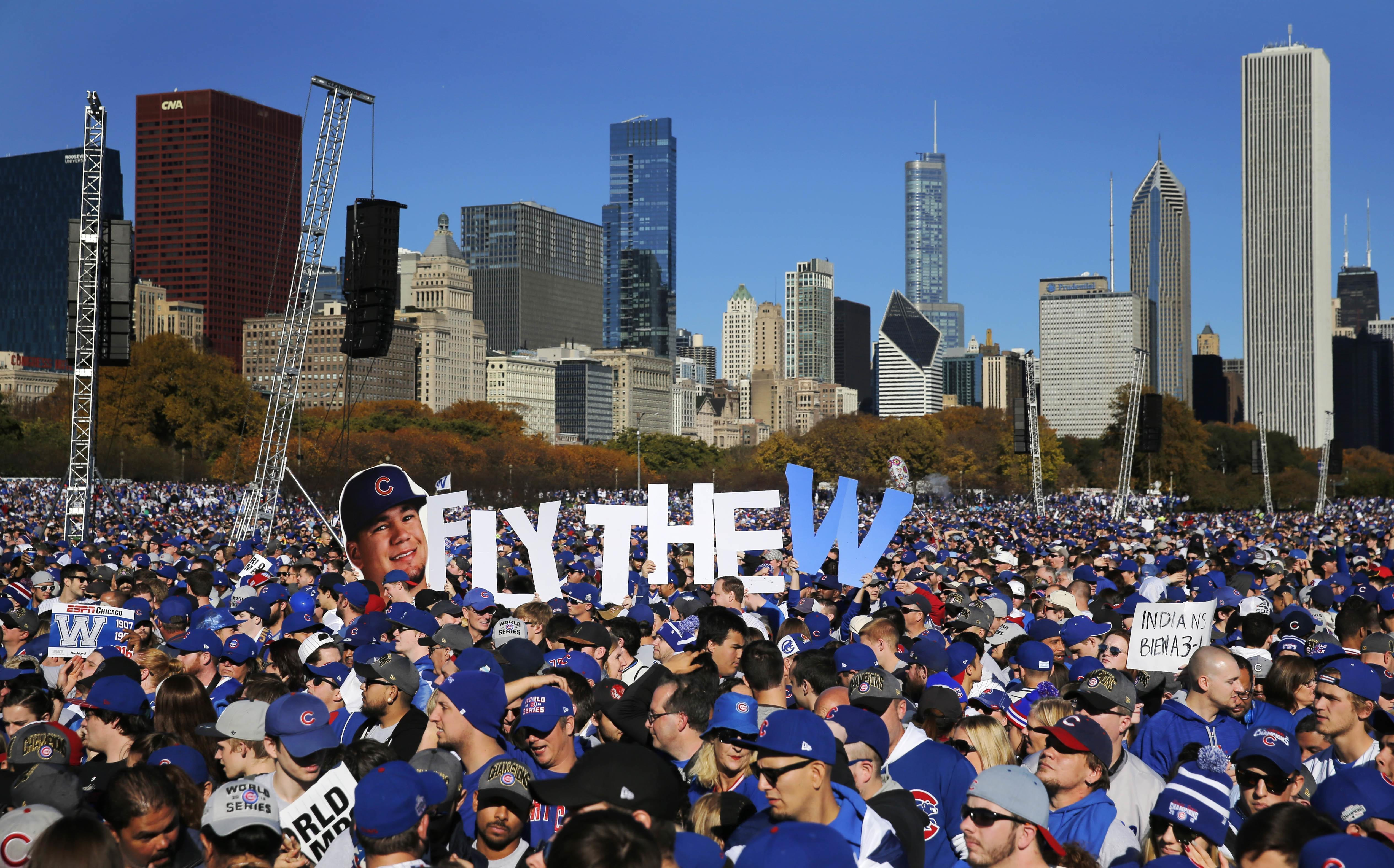 Chicago Cubs fans celebrate during a rally in Grant Park honoring the World Series baseball champions Friday, Nov. 4, 2016, in Chicago's Grant Park.