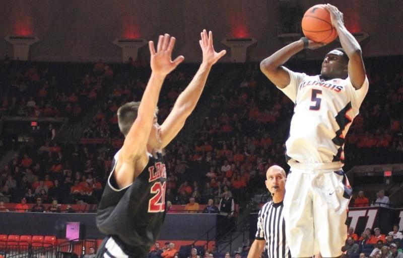 Illinois' Jalen Coleman-Lands shoots a three-pointer over Lewis defender Capel Henshaw.