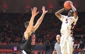 Illinois' Jalen Coleman-Lands shoots a three-pointer over Lewis defender Capel Henshaw.