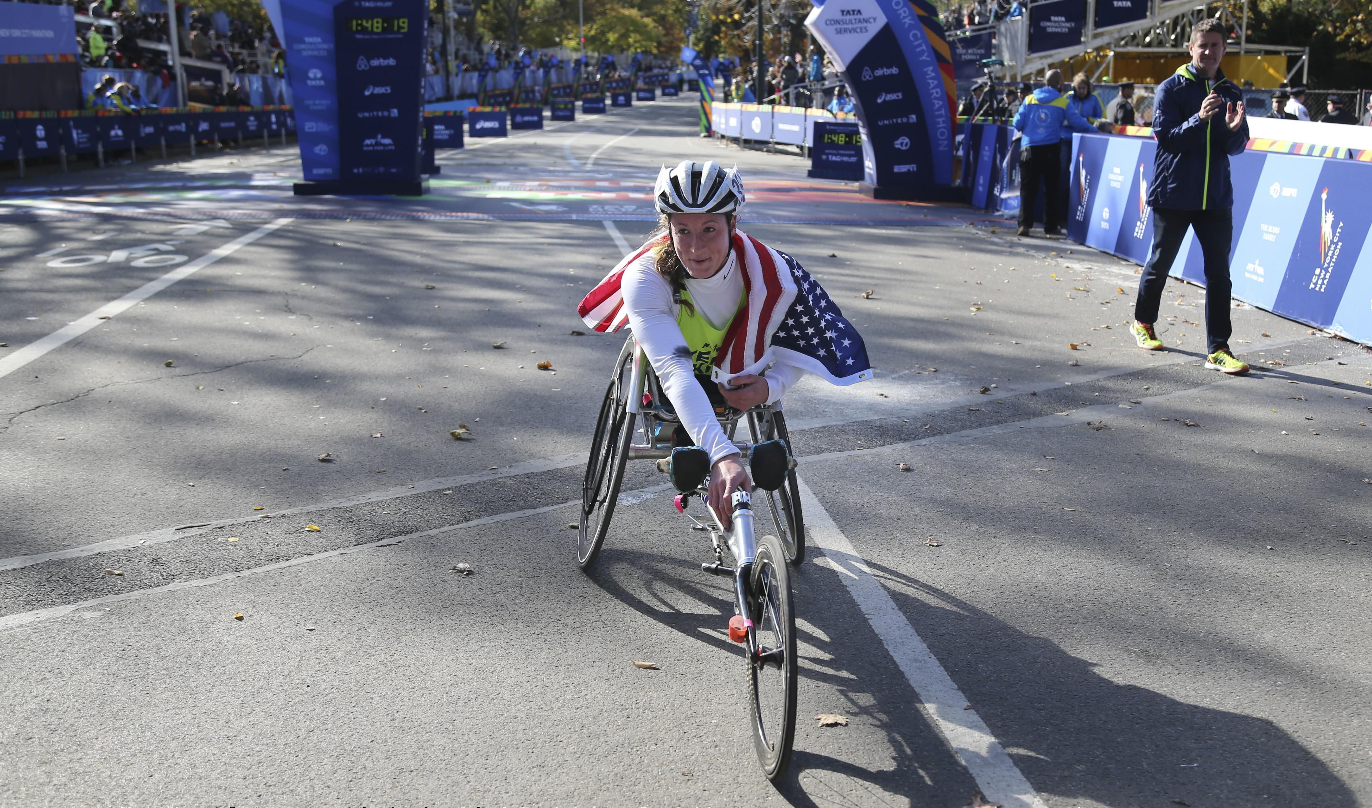 U of I graduate  tatyana McFadden poses for pictures after winning the women's wheelchair division at the 2016 New York City Marathon.