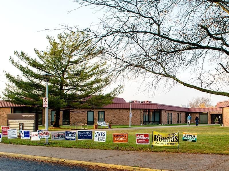 Campaign signs lined  up outside the entrance to the Champaign County Clerk's office in Urbana.