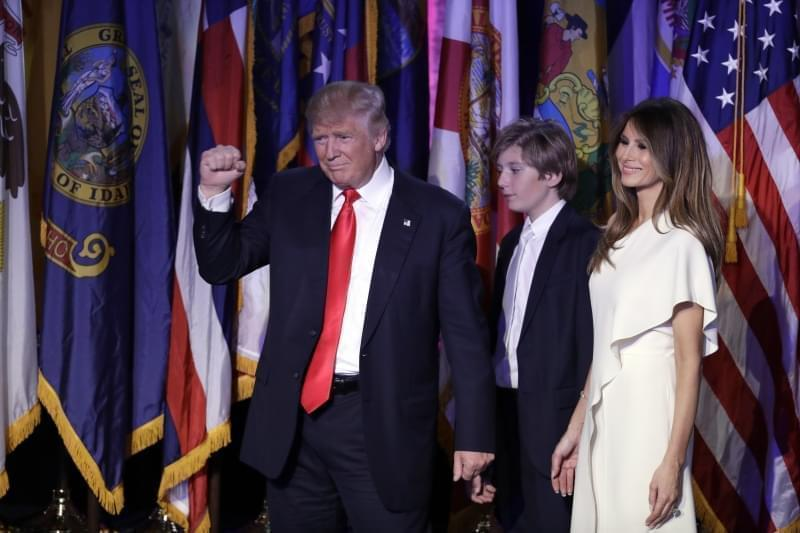President-elect Donald Trump pumps his fist after giving his acceptance speech as his wife Melania Trump, right, and their son Barron Trump follow him during his election night rally, Wednesday, Nov. 9, 2016, in New York.