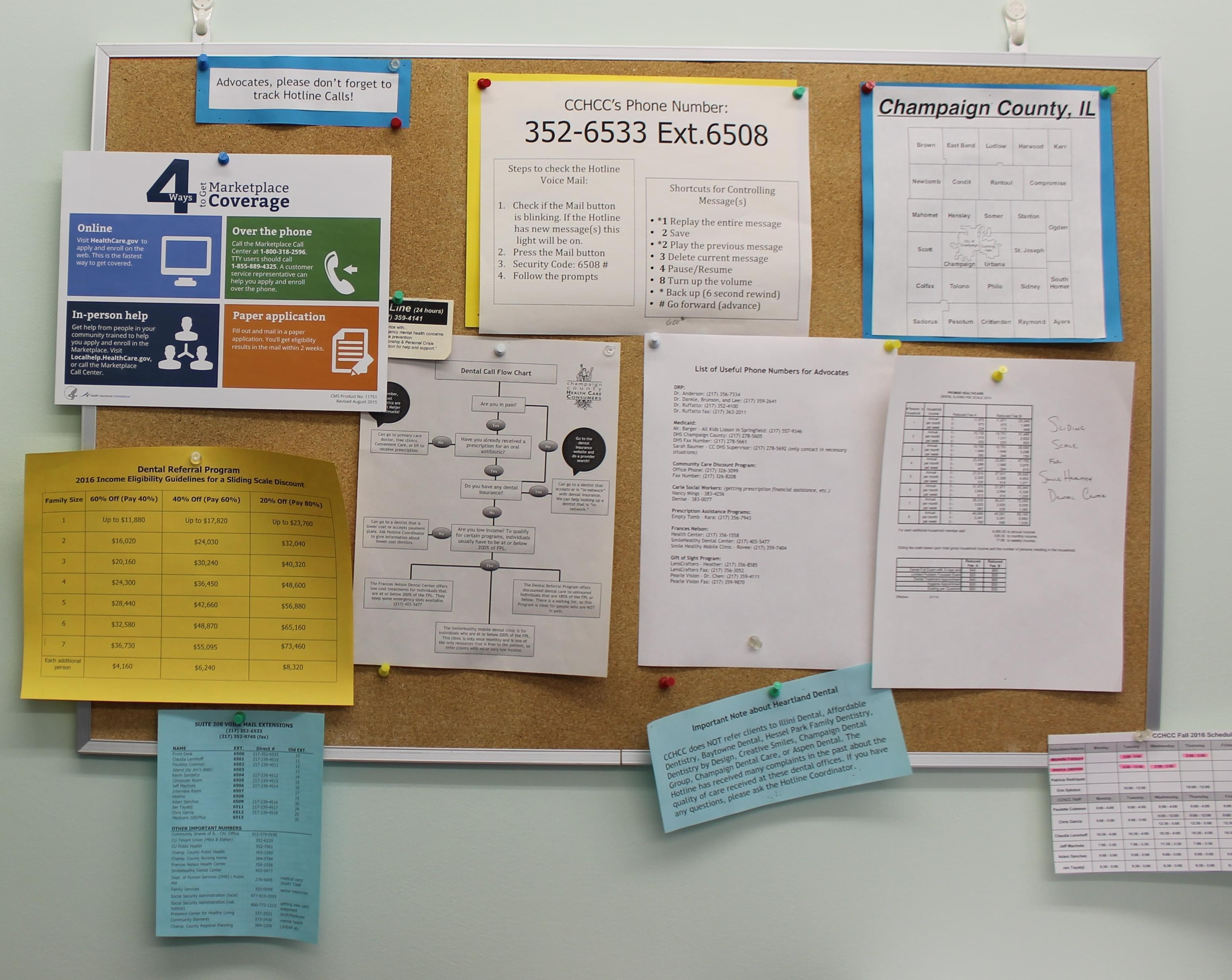 A number of flyers related to health care enrollment are on the walls at Champaign County Health Consumers in Champaign.