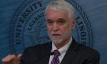 U of I President Tim Killeen discusses the performance-based funding measure before university Trustees Thursday in Chicago.