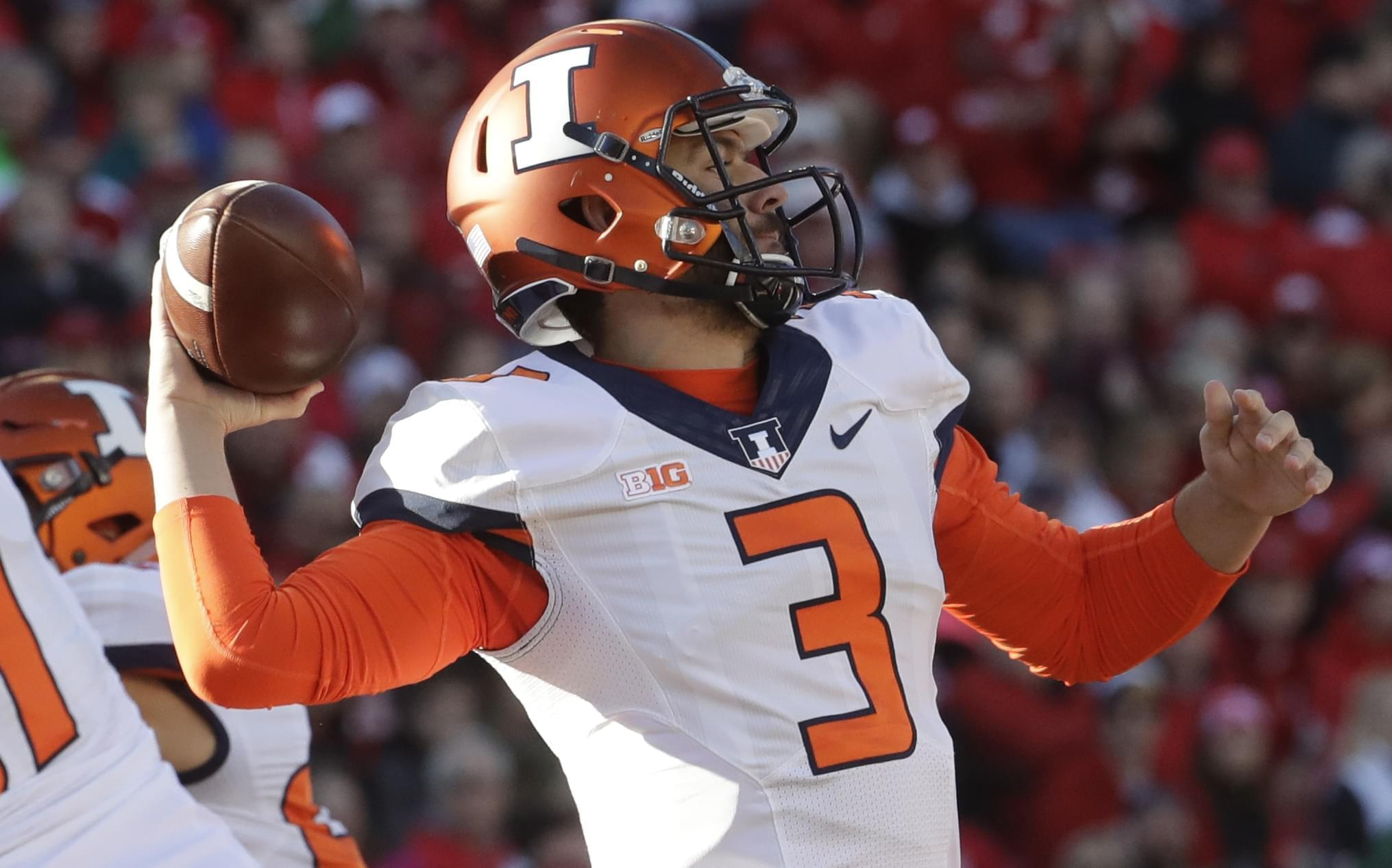 Illinois quarterback Jeff George Jr. throws during the first half of an NCAA college football game against Wisconsin Saturday in Madison, Wis.
