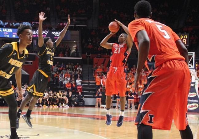 Malcom Hill fires a three-pointer for the Illini.