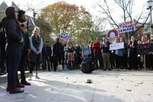 Student protesters rally in from the U of I's alma mater statue on November 11.
