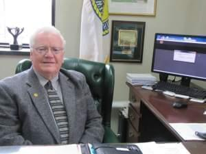 Larry Walsh at his desk.