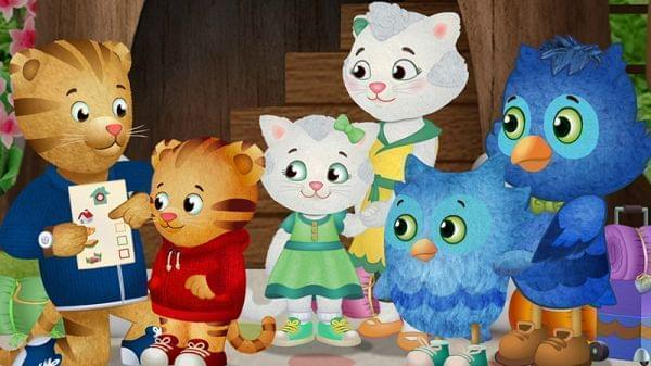 Characters from Daniel Tiger's Neighborhood gather to discuss plans.