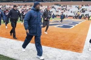 Illinois head coach Lovie Smith walks off the field after being defeated by Iowa 28-0 in an NCAA college football game, Saturday, Nov. 19, 2016 at Memorial Stadium in Champaign, Ill.