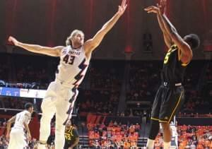 Michael Finke (43) arrives too late to block a three-pointer by Winthrop player Keon Johnson.