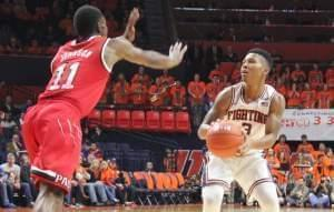 llini Te'Jon Lucas looks to pass against NC state defender Markell Johnson, Tuesday night in Champaign