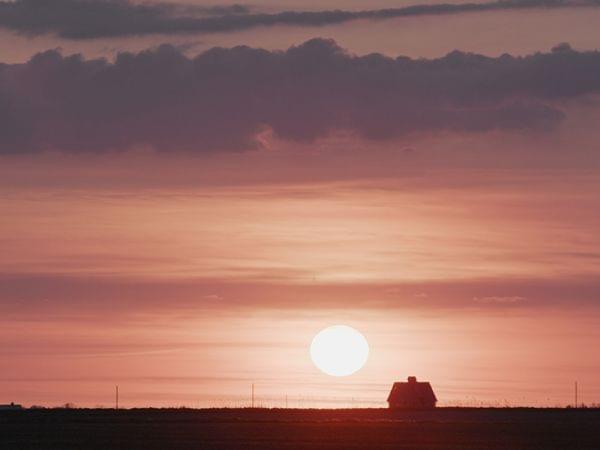 Barn against a sunset
