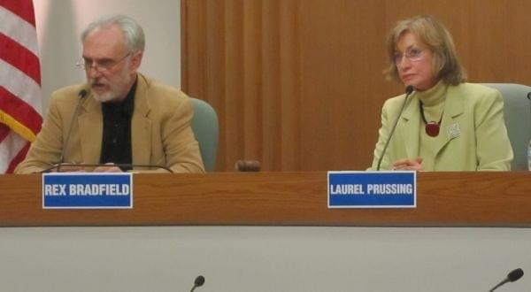 Bradfield debates Urbana Mayor Laurel Prussing in March 2013 at the Champaign City Building.