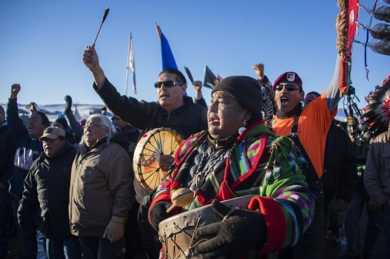 Protestors celebrate at Oceti Sakowin Camp earlier today.