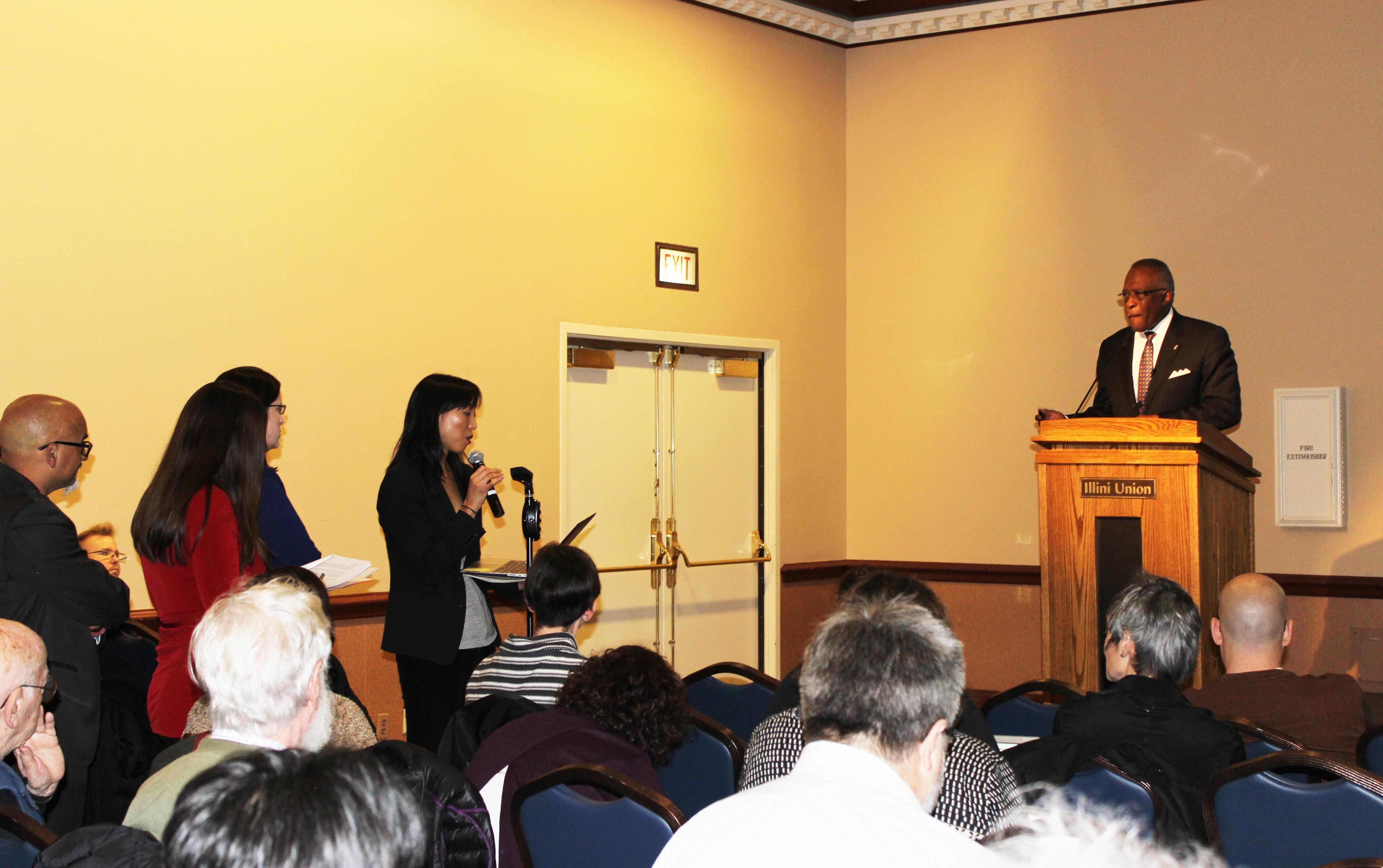 U of I Asian American Studies Professor Naomi Paik addresses Urbana Chancellor Robert Jones and the Academic Senate Monday at the Illini Union.