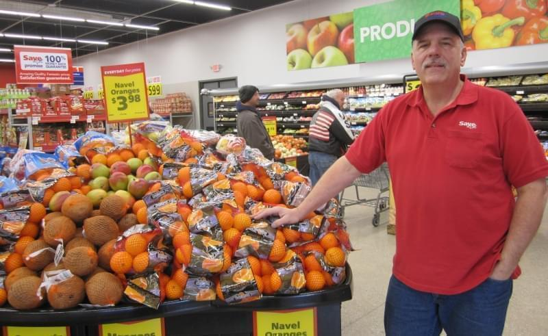 Dave Jackson stands in the produce section of his new and larger Save-A-Lot store in downtown Clinton.