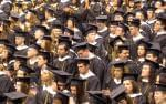 College students in caps and gowns for graduation ceremony.