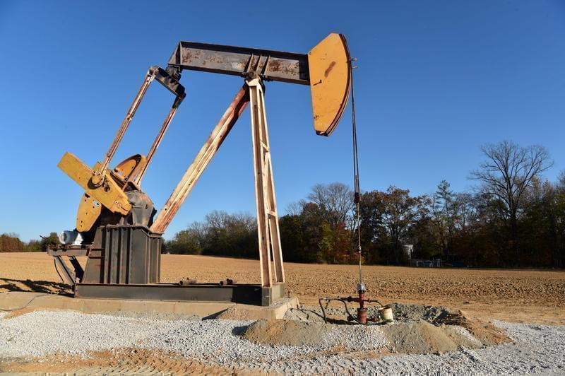 A pump jack sits atop an oil well drilled by Campbell Energy this fall behind the Super 8 hotel in Grayville.