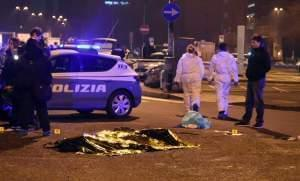 A body is covered with a thermic blanket after a shootout between police and a man near a train station in Milan's Sesto San Giovanni neighborhood,