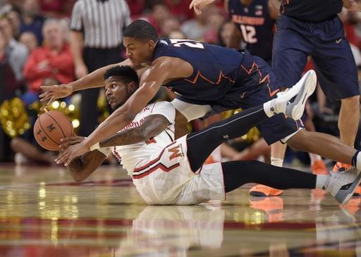 Illinois guard Malcolm Hill, top, fights for the ball against Maryland guard Dion Wiley, bottom, during the first half of an NCAA college basketball game, Tuesday, Dec. 27, 2016, in College Park, Md.