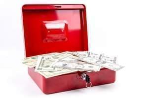 Cashbox with cash inside.
