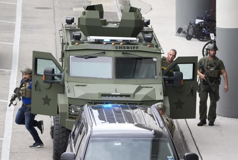 Law enforcement personnel arrive in an armored car outside Fort Lauderdale–Hollywood International Airport, Friday, Jan. 6, 2017, in Fort Lauderdale, Fla. A gunman opened fire in the baggage claim area at the airport Friday, killing several peo