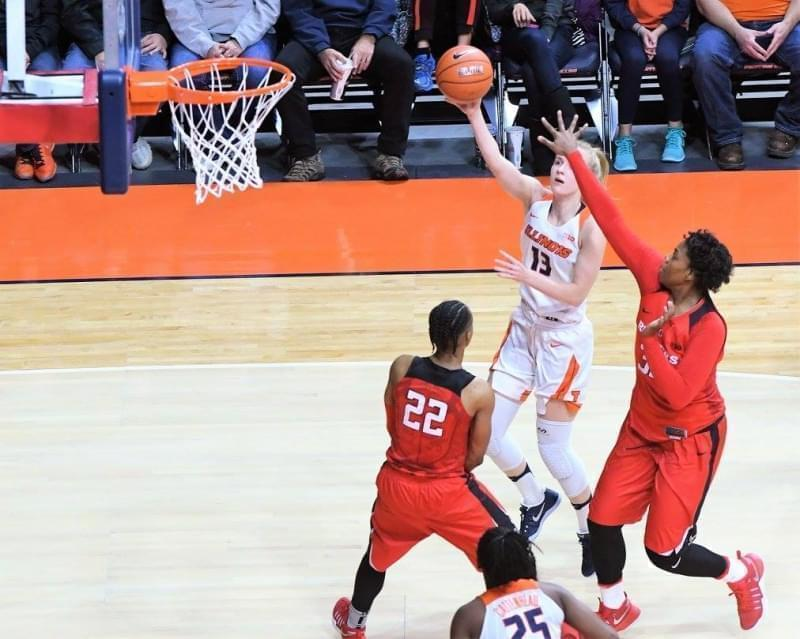 Petra Holešínská shoots over two Rutgers defenders in a 78-41 win.