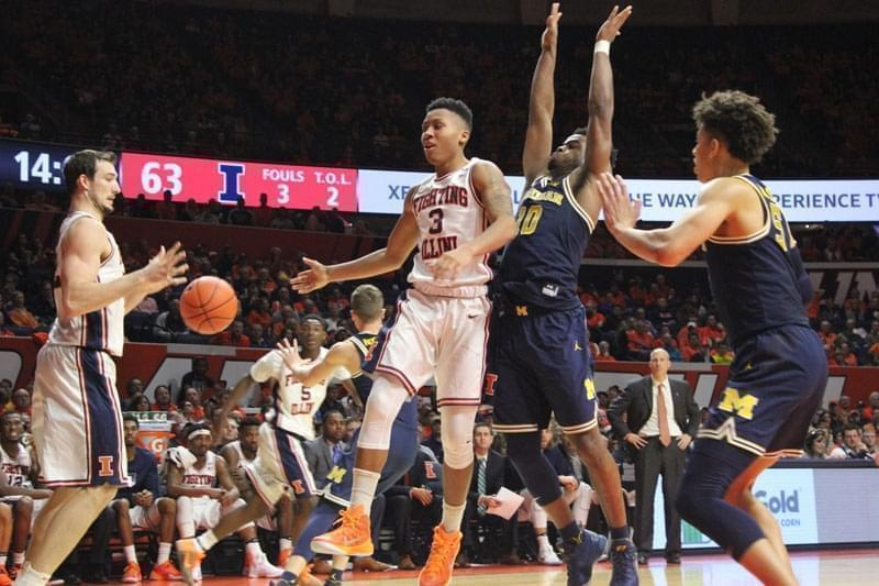 Illini Te'Jon Lucas (3) dumps a no-look assist to Maverick Morgan (22) in Wednesday's 85-69 win over Michigan, in Champaign.