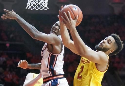 Illinois' forward Leron Black tries to bat away a rebound by Maryland's guard Melo Trimble.