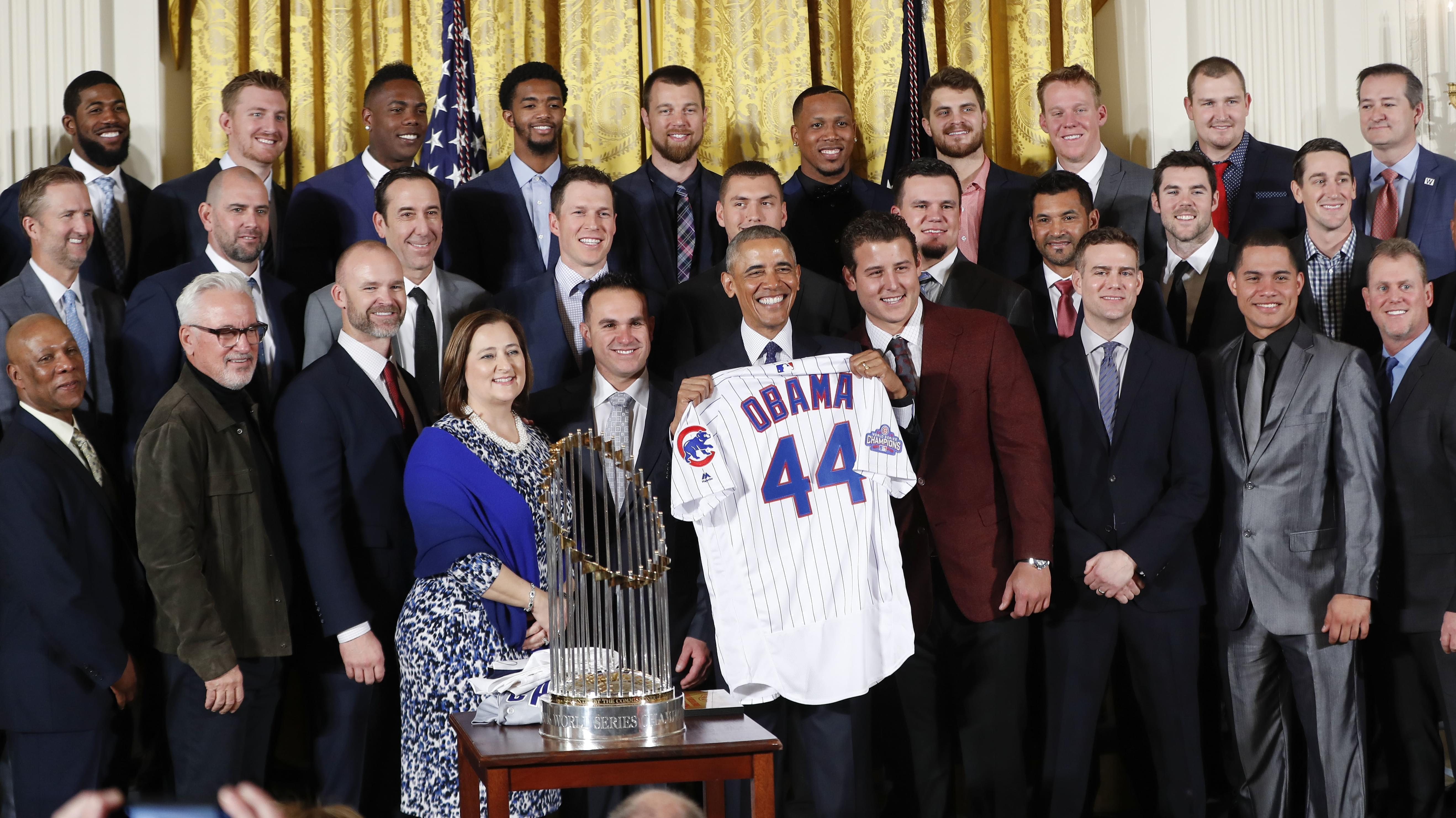 President Barack Obama holds up a personalized Chicago Cubs baseball jersey presented to him for a group photo during a ceremony in the East Room of the White House in Washington, Monday, where the president honored the 2016 World Series Champion bas