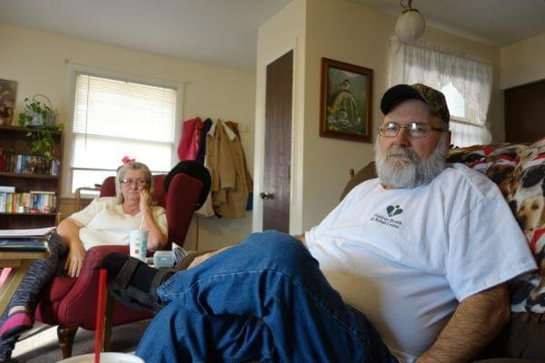 Allen Wilson sitting with his wife.