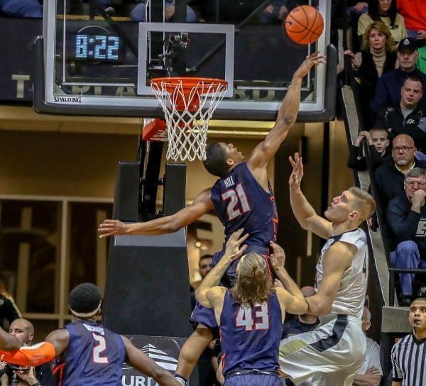 Illini Malcolm Hill rejects Purdue's Isaac Haas during the Boilermakers 91-68 win over Illinois.