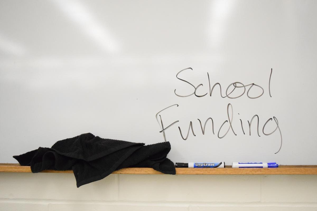 White board with school funding written on it.