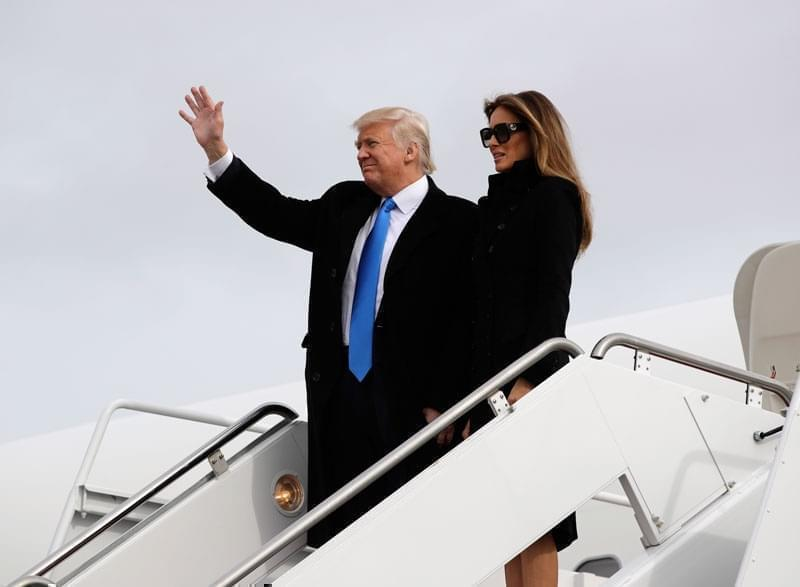 President-elect Donald Trump, accompanied by his wife Melania, waves as they arrive at Andrews Air Force Base, Md., Thursday, Jan. 19, 2017, in advance of Friday's inauguration.
