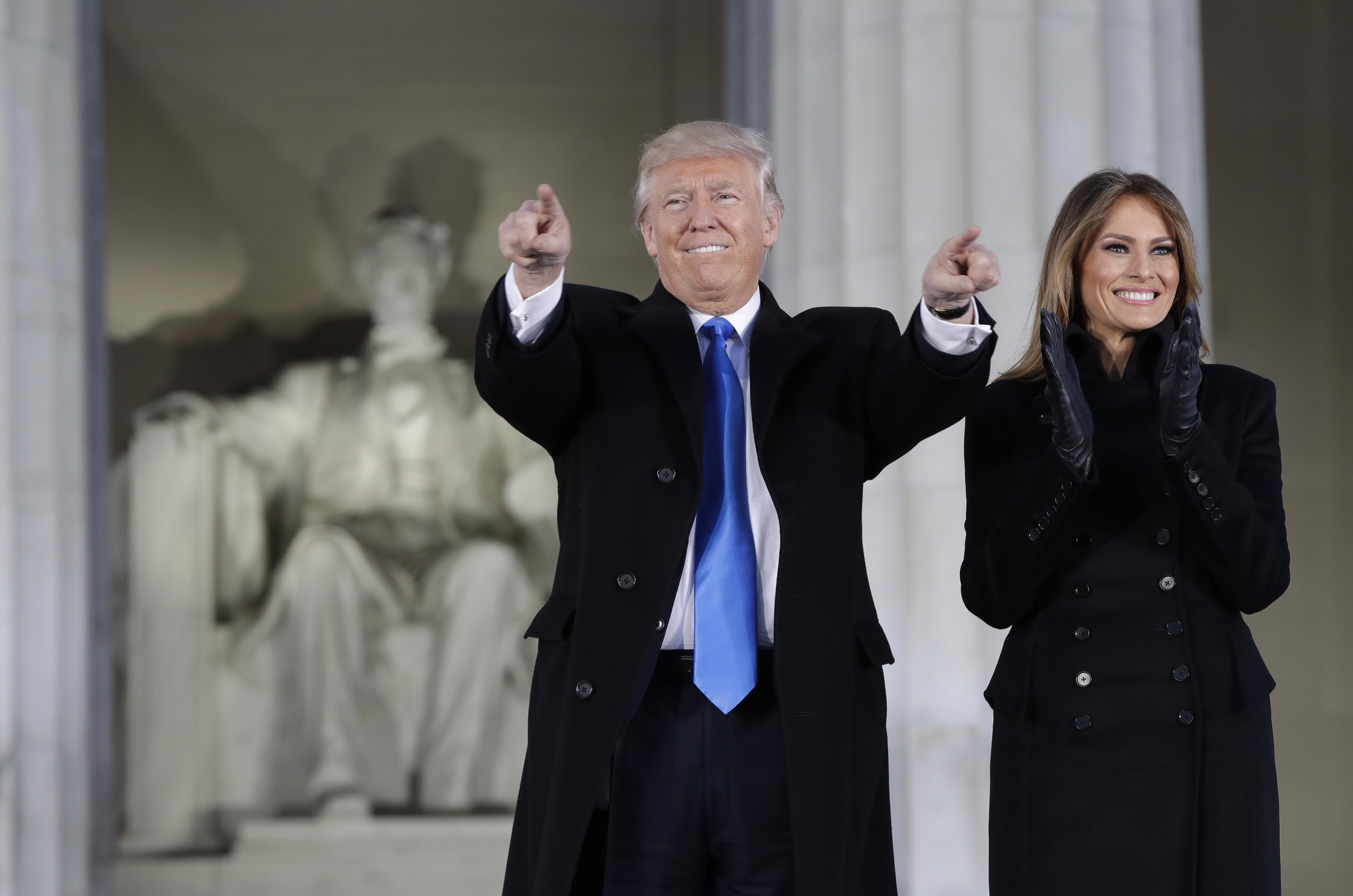 "President-elect Donald Trump and his wife Melania Trump arrive at a pre-Inaugural ""Make America Great Again! Welcome Celebration"" at the Lincoln Memorial in Washington, Thursday, Jan. 19, 2017."
