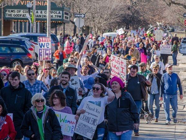 Participants in Saturday's Women's March in downtown Champaign make their way down Park Avenue.