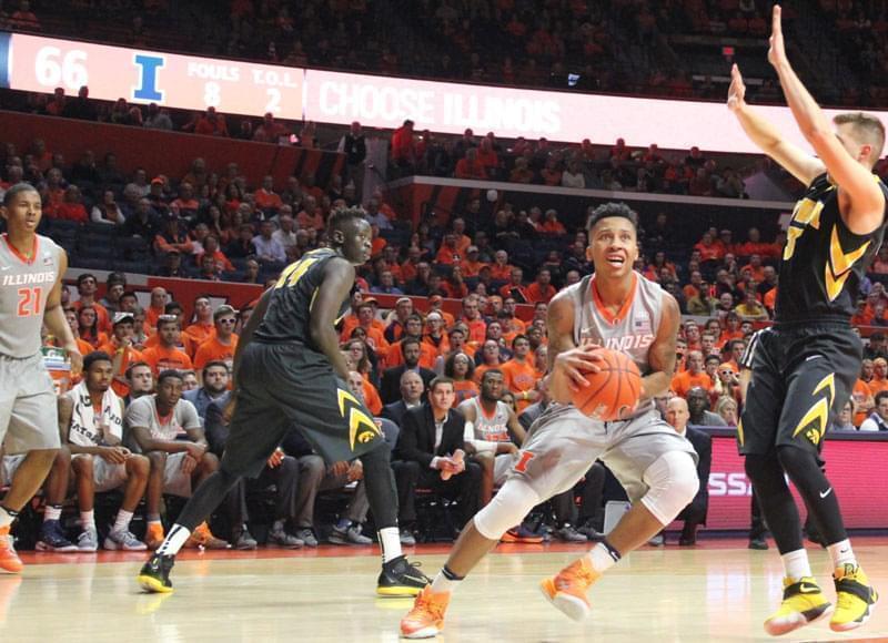 Illini Te'Jon Lucas drives to the basket as teammate Malcolm Hill (21) looks on.