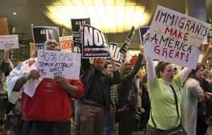 People opposed to President Donald Trump's executive order barring entry to the U.S. by Muslims from certain countries demonstrate at the Tom Bradley International Terminal at Los Angeles International Airport Saturday, Jan. 28, 2017
