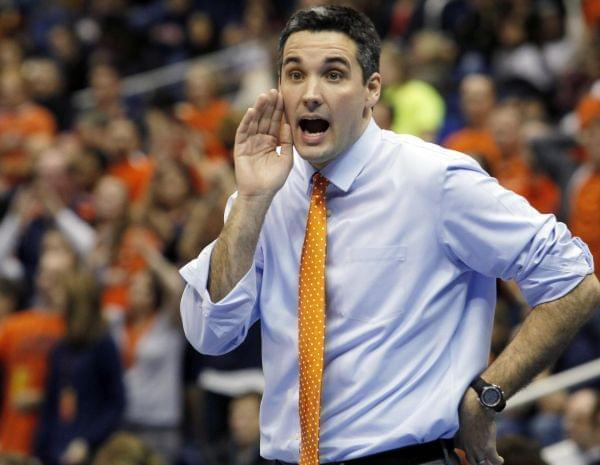 Former Illinois head coach Kevin Hambly yells to his players during an NCAA college semifinals volleyball match against USC, Thursday, Dec. 15, 2011, in San Antonio.