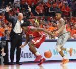 Illini coach John Groce avoids contact with Wisconsin's Nigel Hayes, Tuesday night in Champaign