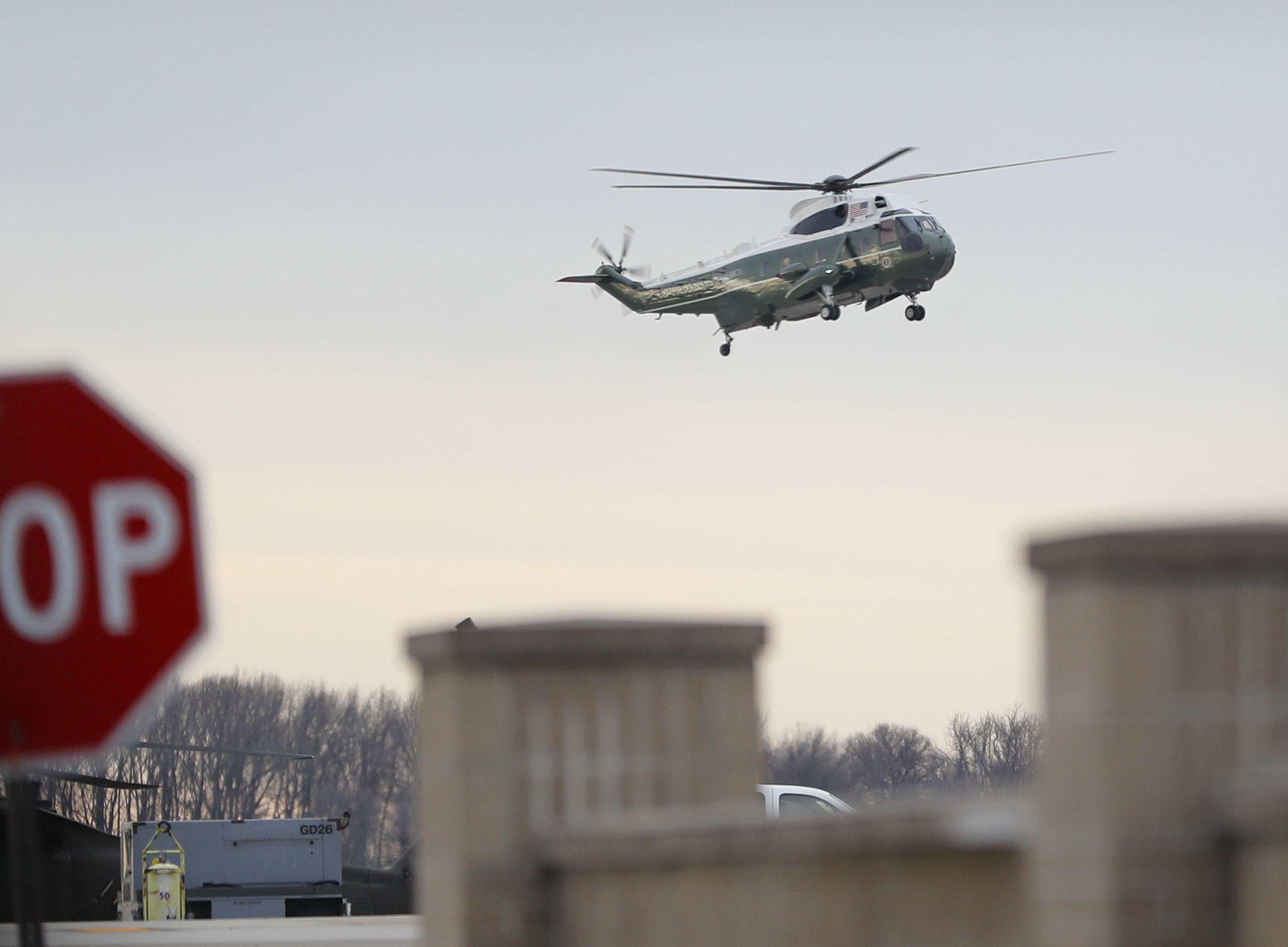"""Marine One, with President Donald Trump, lands at Dover Air Force Base, Del. Wednesday, Feb. 1, 2017. Trump traveled to Dover AFB to meet with family members of Chief of Special Warfare Operator William """"Ryan"""" Owens 36, of Peoria."""