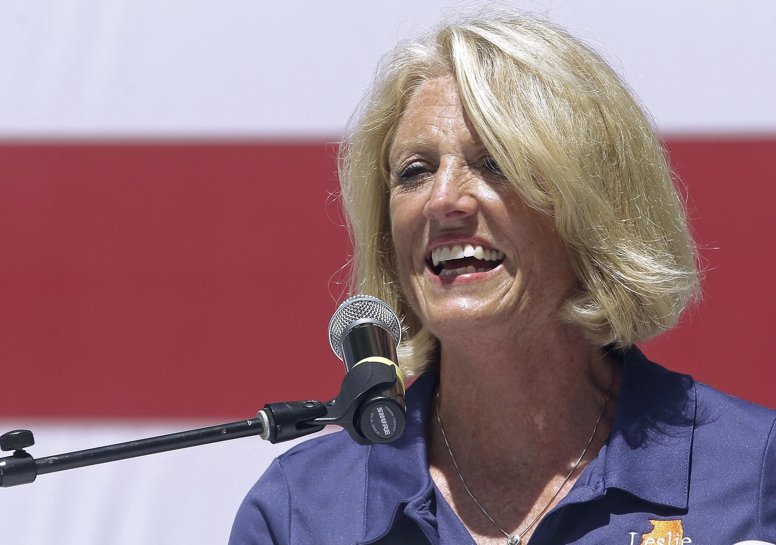 This Aug. 17, 2016, file photo shows, then Republican Illinois state Comptroller Leslie Munger in Springfield, Ill. Illinois Gov. Bruce Rauner has hired former state Comptroller Munger to serve as a deputy governor.