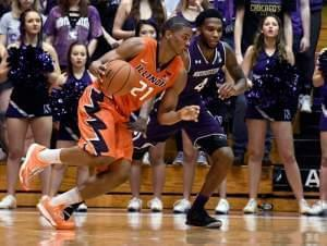 Illinois guard Malcolm Hill (21) is defended by Northwestern forward Vic Law (4) during the second half of an NCAA college basketball game Tuesday, Feb. 7, 2017, in Evanston, Ill. Illinois won 68-61.