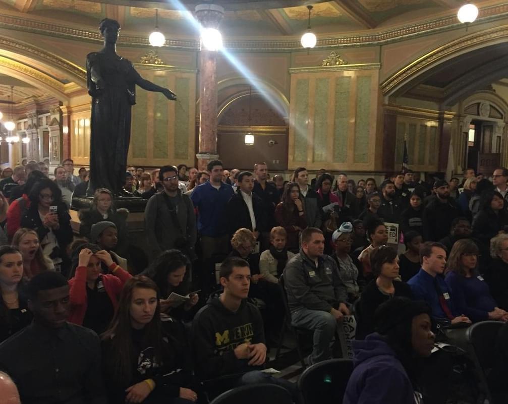 Students rally at the Capitol Rotunda Wednesday.